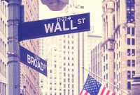 Wall Street and Broad Street signs, color toning applied, New York City, USA.
